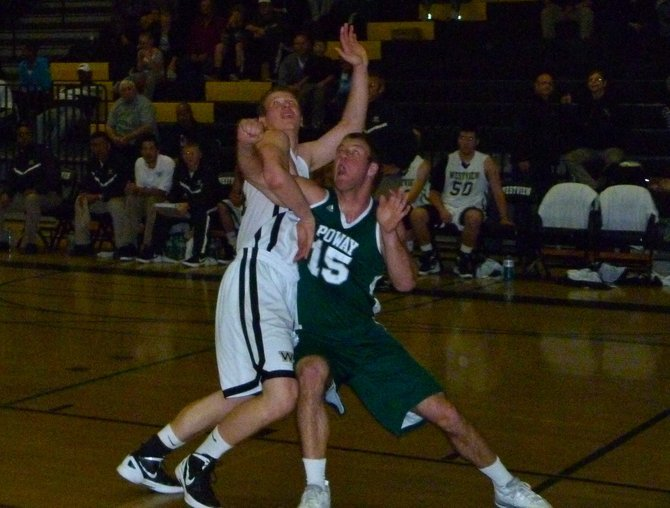 Poway forward Brian Guendling and Westview forward Sam Okhotin jockey for rebounding position underneath the basket