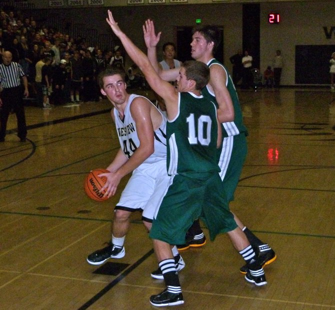 Westview forward Patrick Govea navigates the Poway double team of guard Tom Erb (near) and center Sam Beeler