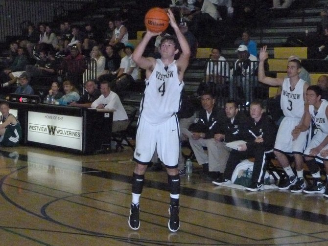 Westview guard Blake Watkins shoots a wide open three-pointer from the wing