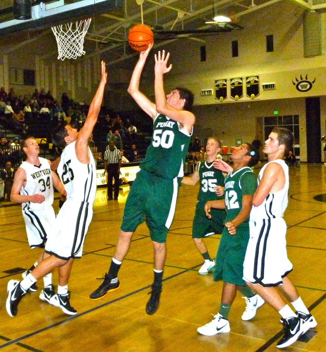 Poway center Sam Beeler puts up a short fadeaway over Westview guard Cody Williams