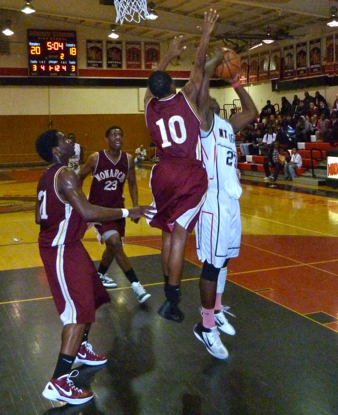 Mount Miguel forward Cory Littleton shoots over outstretched Monte Vista guard D'ondre Coleman