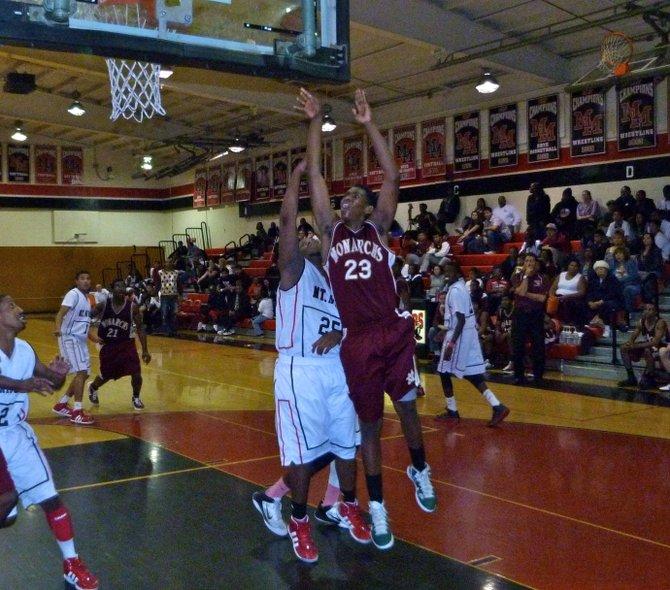 Monte Vista forward James Jackson shoots a leaner over Mount Miguel forward Thomas Butler