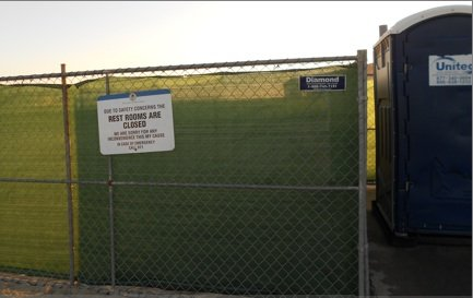 Construction fencing recently erected at site of demolished bathrooms