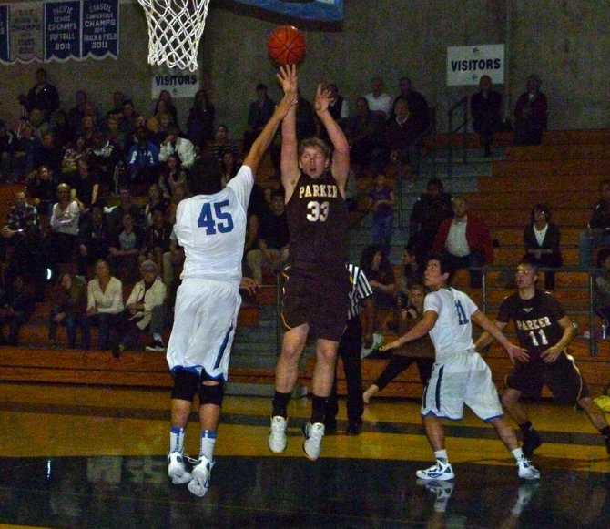 Francis Parker center Bryce Fitzner shoots a jumper over La Jolla Country Day forward Frank Bamford