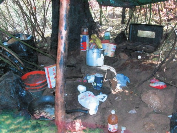The growers' breakfast was still cooking via a small fire under a flat rock that served as a griddle for tortillas and beans.