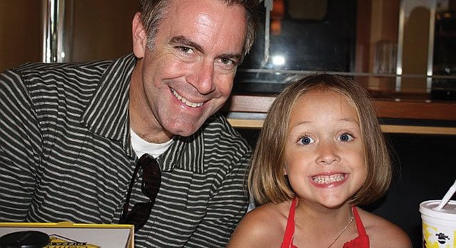 """Kevin Womack (with daughter Zoe). """"We don't want to hold a Christian version of an aerobics class."""""""
