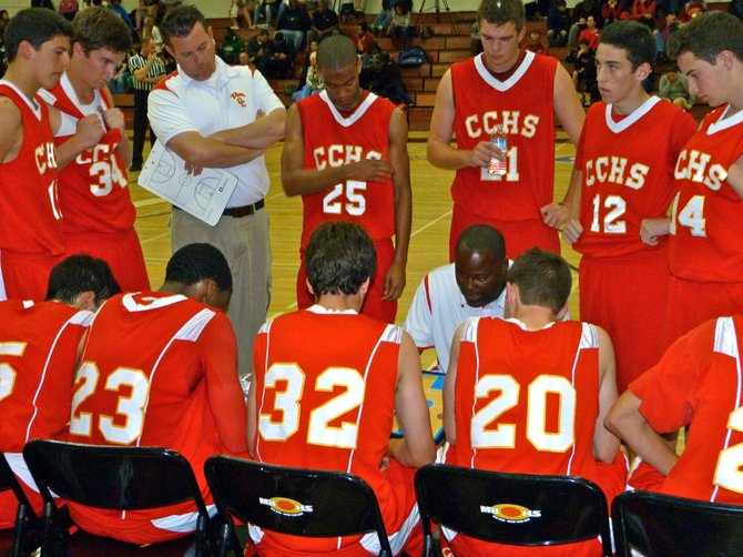 Cathedral Catholic head coach Will Cunningham draws up a play for the Dons during a timeout