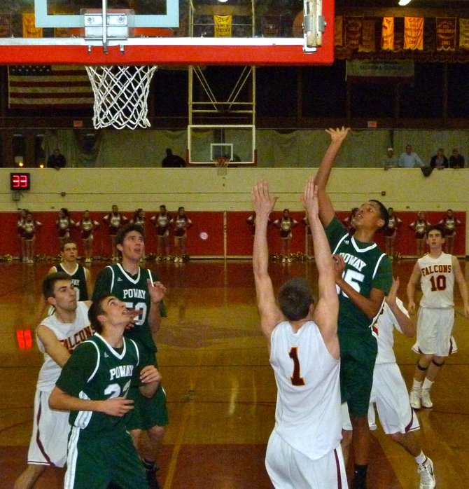 Poway guard Brandon Dumas floats a shot in the lane over Torrey Pines guard Joe Rahon