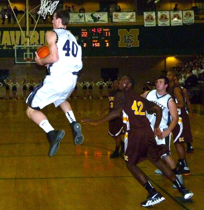 La Costa Canyon forward Matt Shrigley grabs a failed alley-oop pass in midair