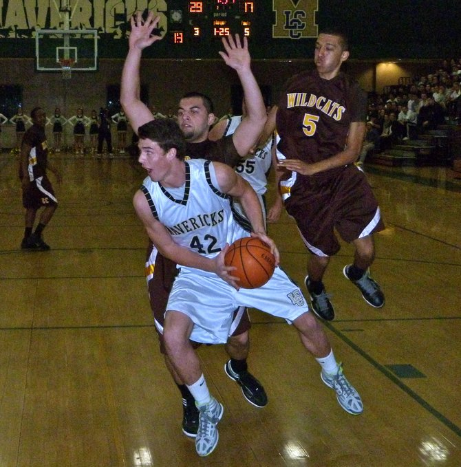 La Costa Canyon forward Brandon Miller drives baseline in front of El Camino forward Travis Pao Pao (left) and guard Lorenzo Garcia