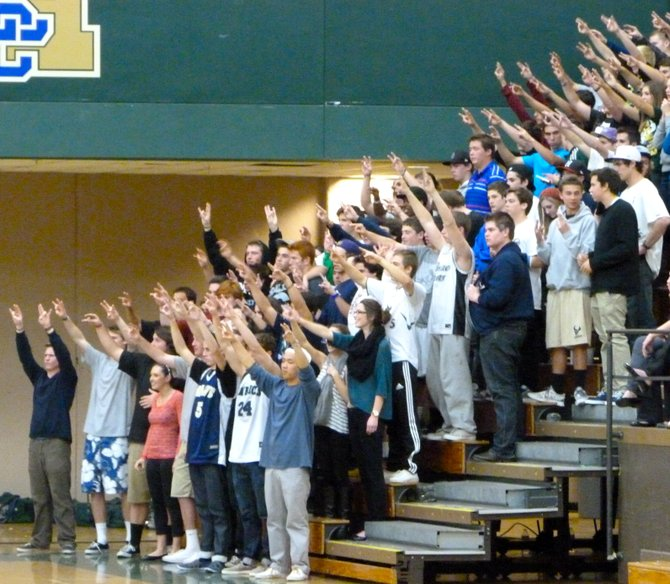 La Costa Canyon's student section holds its hands up during a Mavericks free throw attempt