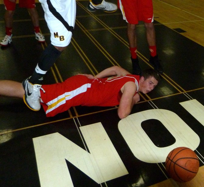 Cathedral Catholic forward Brendan Reh watches from the floor as the ball rolls out of bounds