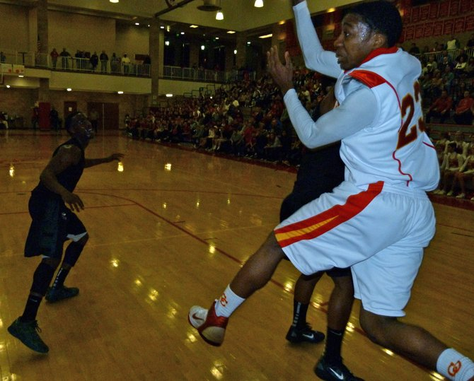 Cathedral Catholic forward Xavier Williams saves the ball in acrobatic fashion underneath the basket