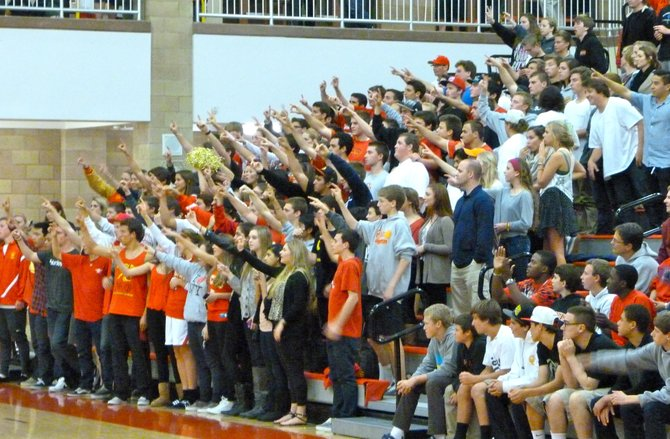 Cathedral Catholic's student section puts its hands in the sky during a Dons free throw attempt
