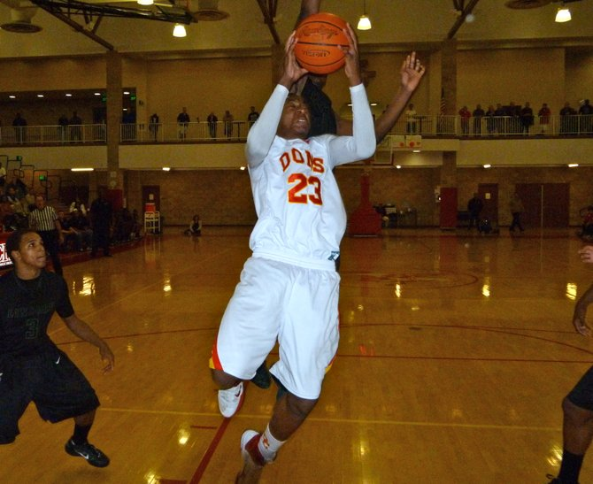 Cathedral Catholic forward Xavier Williams elevates to the basket