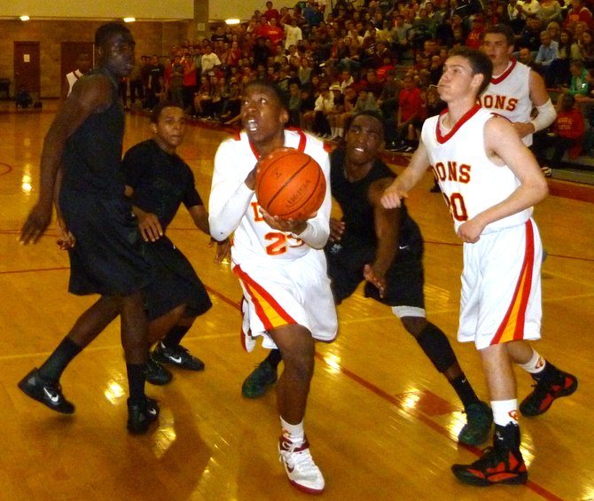 Cathedral Catholic Xavier Williams drives past three Lincoln defenders into the lane