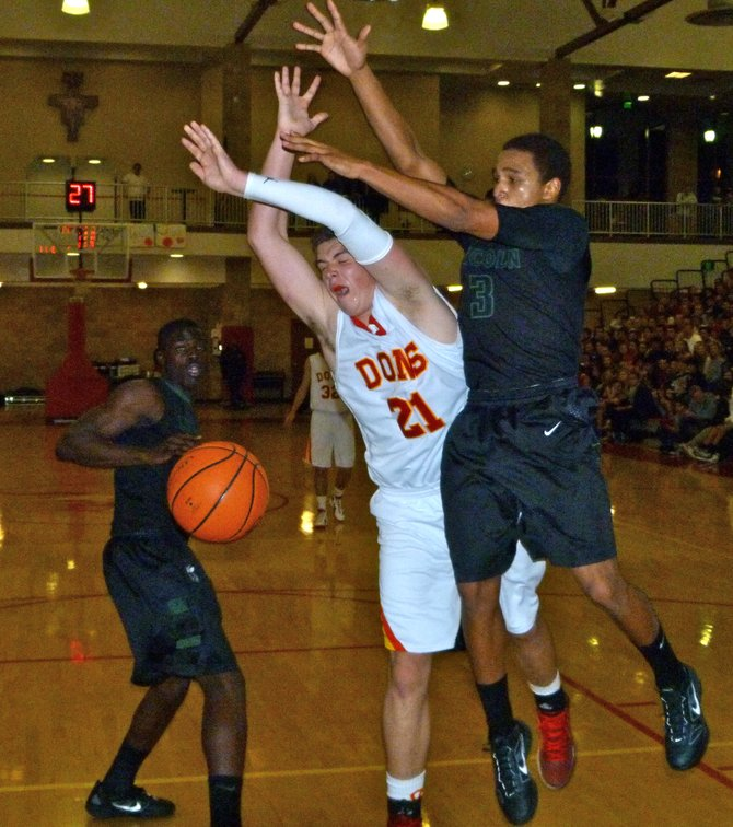 Cathedral Catholic forward Brendan Reh loses the ball in midair between two Lincoln defenders