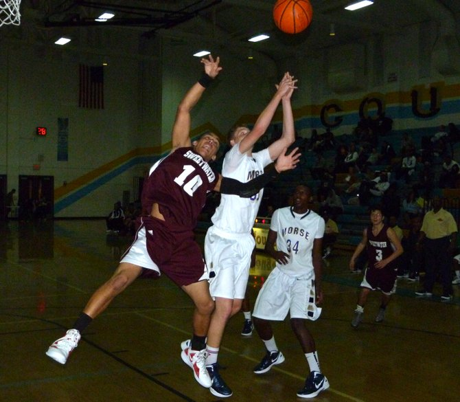 Morse forward Corey Phillps and Sweetwater guard Zach Crutcher fight for a rebound in midair