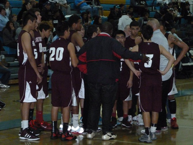 Sweetwater in the huddle during a timeout
