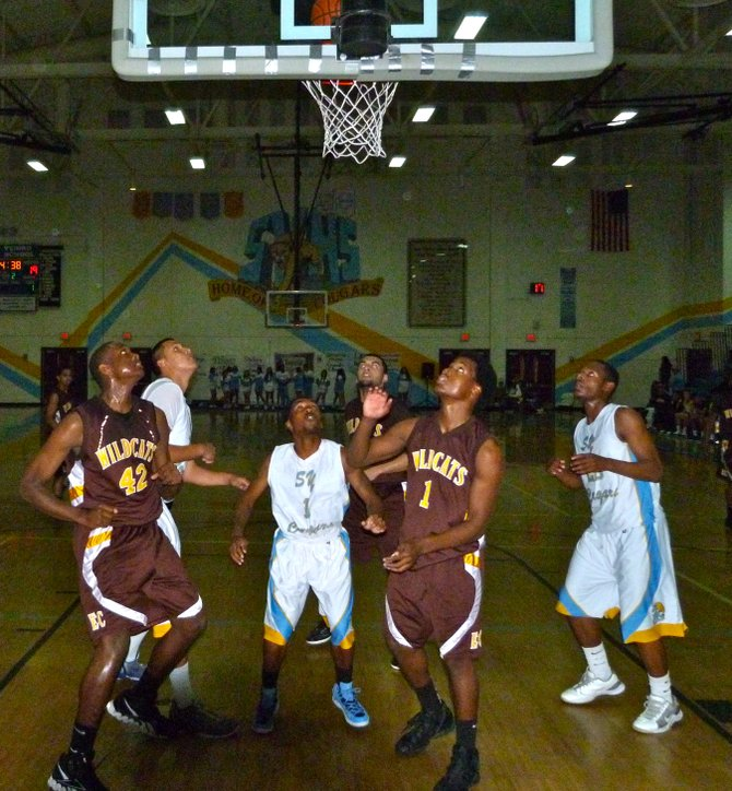 El Camino and San Ysidro players keep their eyes on the basket as a Wildcats shot falls in