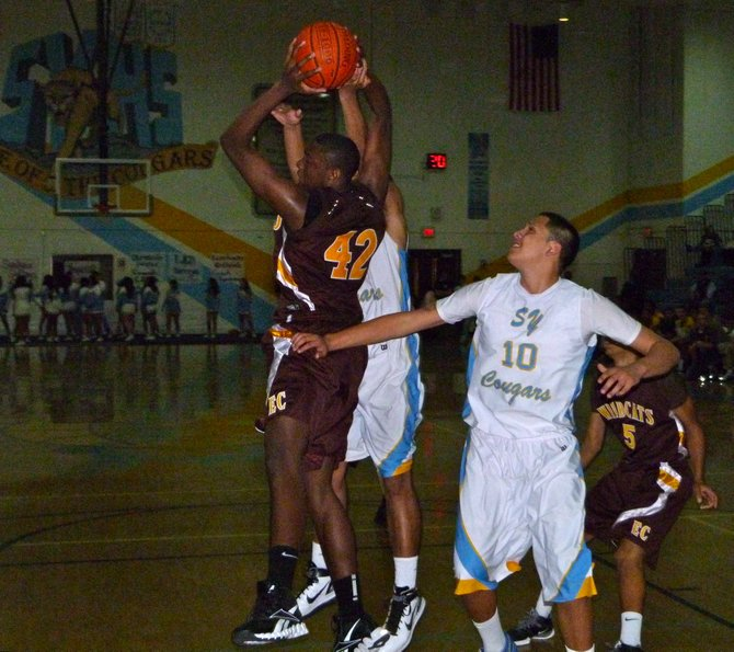 El Camino center Danny Garner Jr. pulls down a rebound between two San Ysidro players