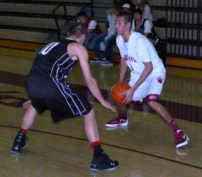 Mission Hills Symeon Martinez guarded by Vista guard Niko Stoner on the perimeter