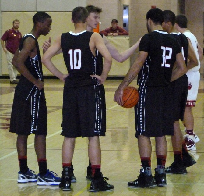 Vista players huddle up on the court during a break in the action