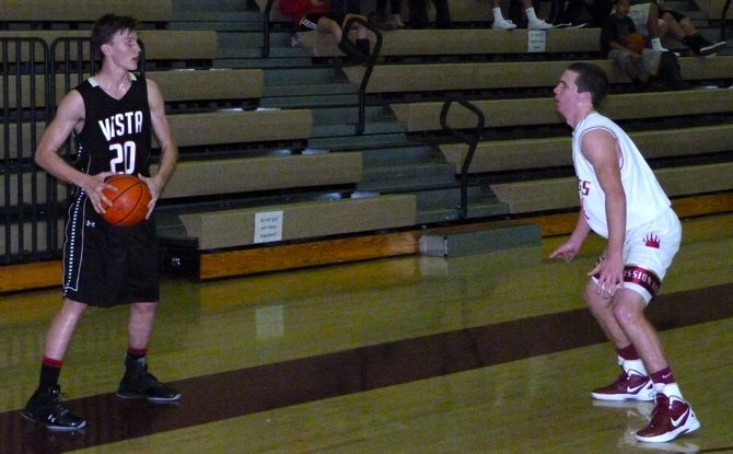 Vista forward Collin Nyenhuis looks for a teammate with Mission Hills guard Nate Delaney defending the inbounds pass