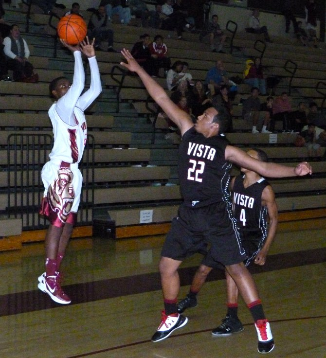 Mission Hills guard Dolyn Hall shoots a jump shot over Vista forward Patrick Johnson