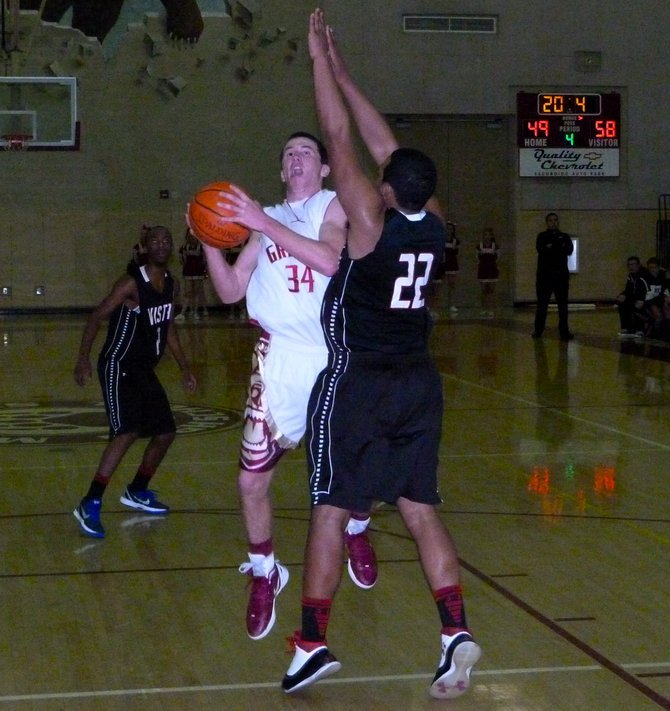 Mission Hills guard Nate Delaney drives against Vista forward Patrick Johnson