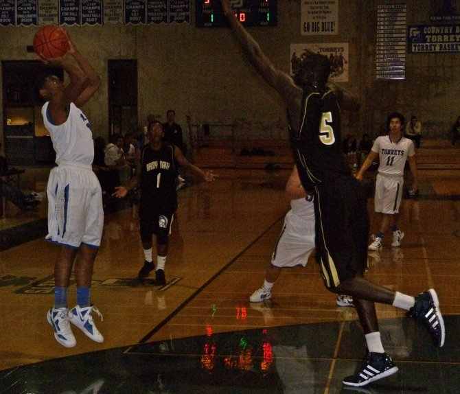 La Jolla Country Day guard Christian Hayes shoots a jumper over Army-Navy center Cheikh N'diaye
