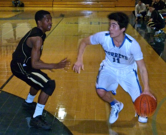 La Jolla Country Day guard Kai Tuites drives against Army-Navy guard Devin Watson