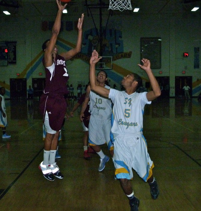 Sweetwater forward Raven Middleton puts up a shot in front of San Ysidro guard Keeko Sinegal