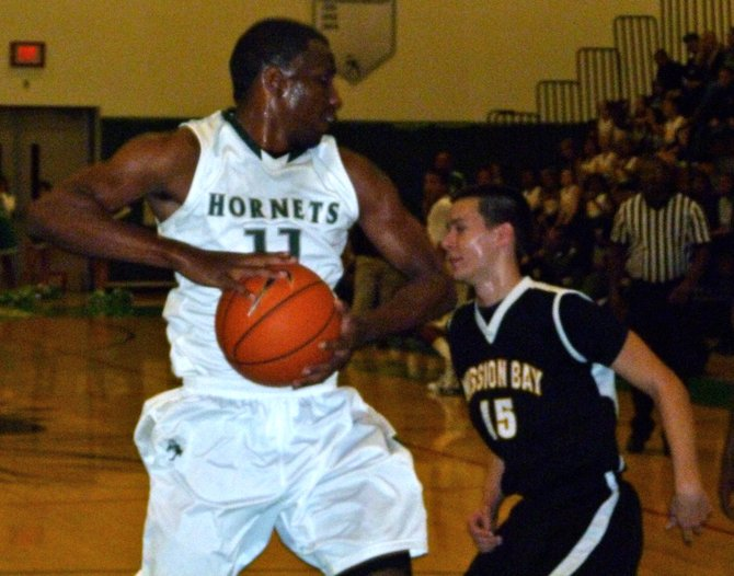 Lincoln guard Jerry Cobb pulls down a rebound