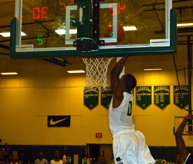 Lincoln guard Tyrell Robinson hauls in a pass at the rim