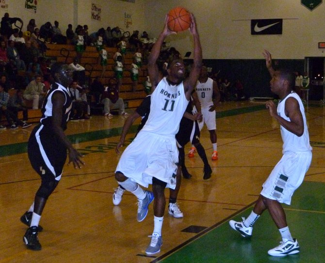 Lincoln guard Jerry Cobb takes off to the hoop