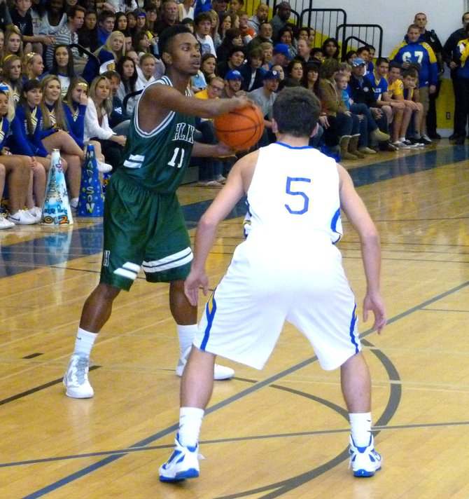Helix guard Titus Young guarded by Grossmont guard Jake Herrod on the perimeter