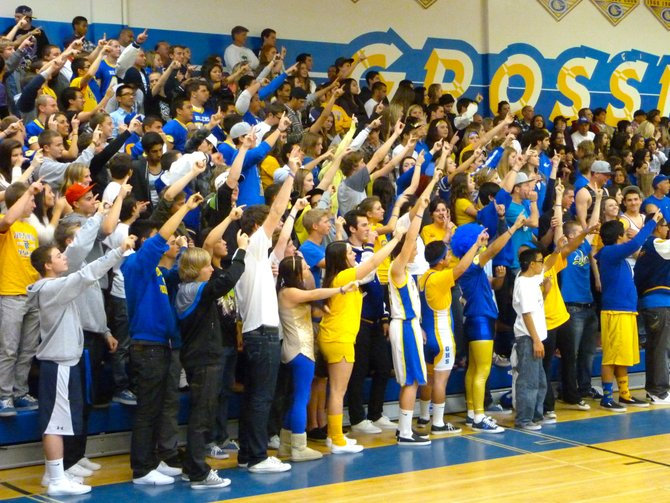 Grossmont's student section holds up a collective finger during a Foothillers free throw attempt