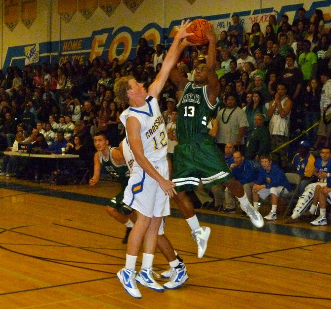 Helix guard Titus Young puts up a shot against Grossmont guard J.T. Barnes