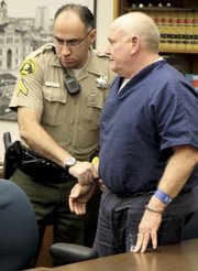 "At his sentencing in January, Keigwin (right) said  ""I am sad for the death of John Watson"""