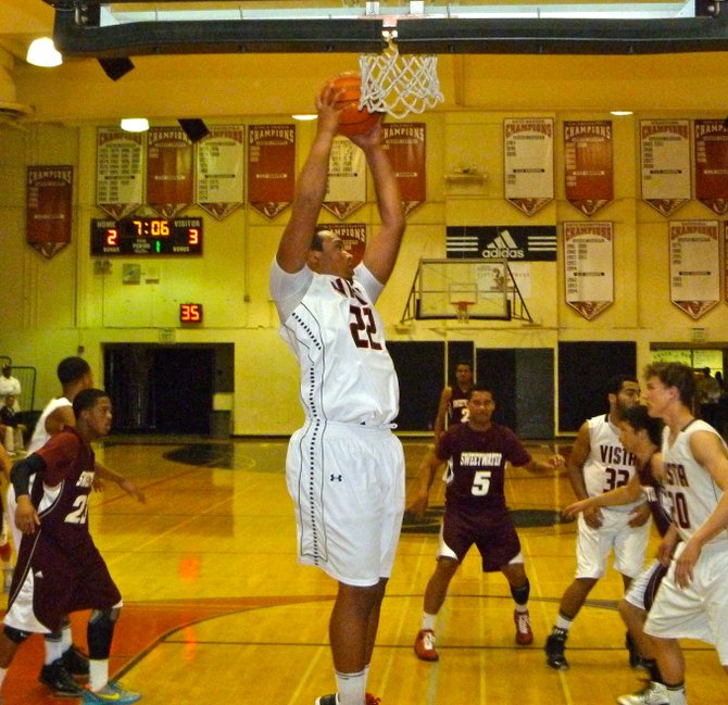 Vista forward Patrick Johnson pulls down a rebound in the lane