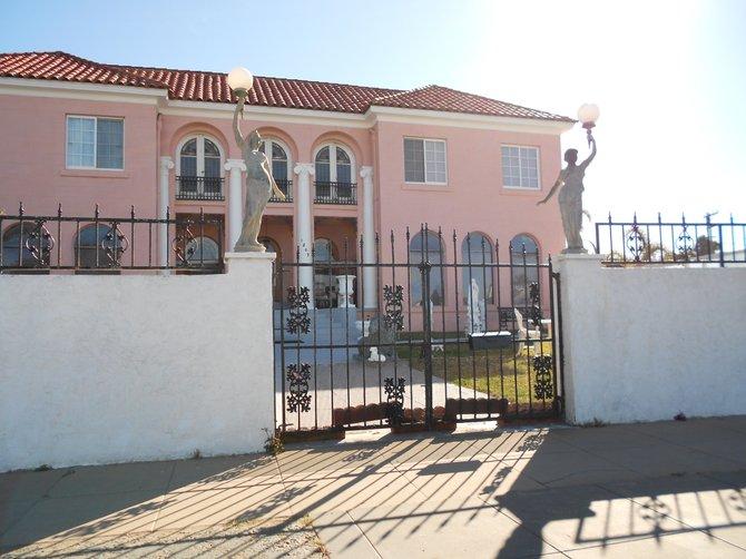 Regal pink mansion along Sunset Cliffs Blvd.