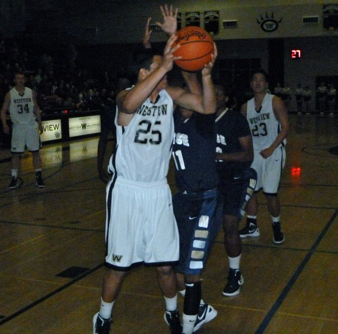 Westview forward Cody Williams goes up for a shot in front of Morse guard Marley Simmons