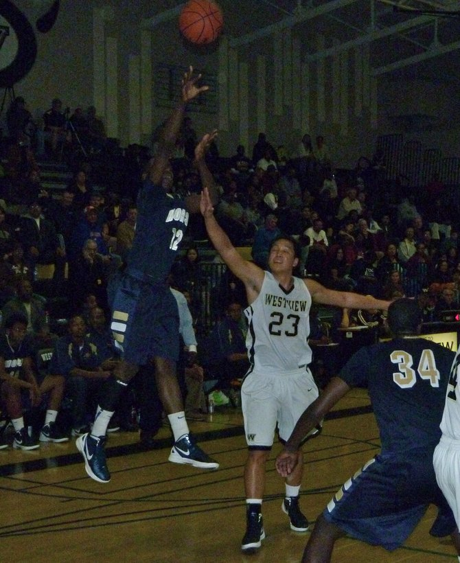 Morse guard Jah'mere Mitchell shoots a jumper over Westview guard Ryan Pineda