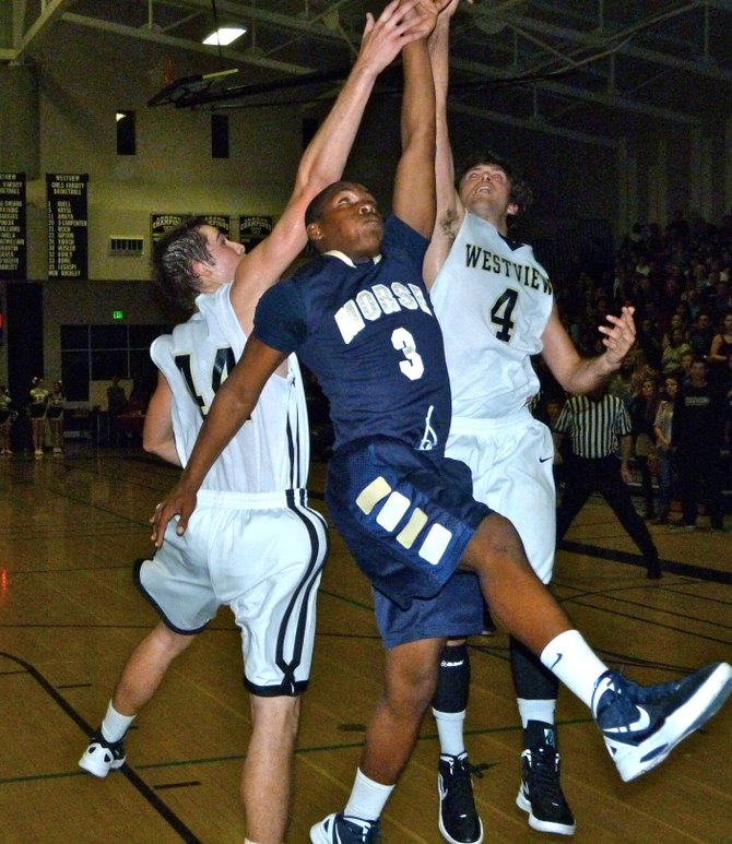 Morse guard Alfonso Wilson fights for a rebound with Westview forward Patrick Govea (left) and guard Blake Watkins