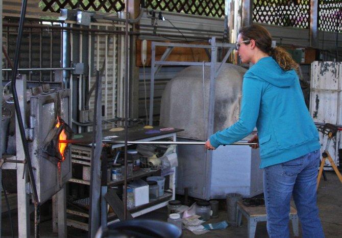 A glass blower at work at the Bernardo Winery in Rancho Bernardo.