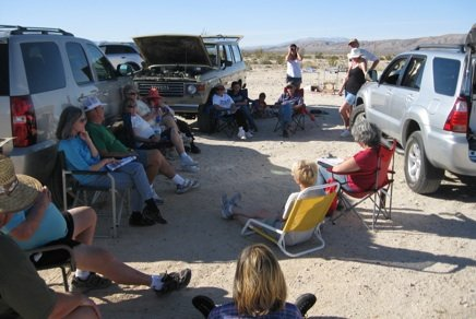Concerned citizens met in the desert to discuss the windmill farm.