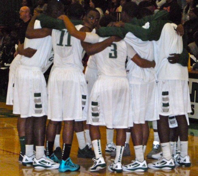 Lincoln players huddle up before taking on Hoover in the Division II semifinals