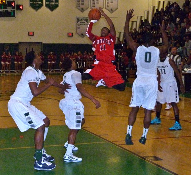 Hoover guard Damonte Holiday hangs in the air to put up a shot between three Lincoln defenders