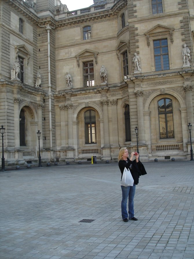 All by myself taking photos of the Louvre in Paris from the courtyard.